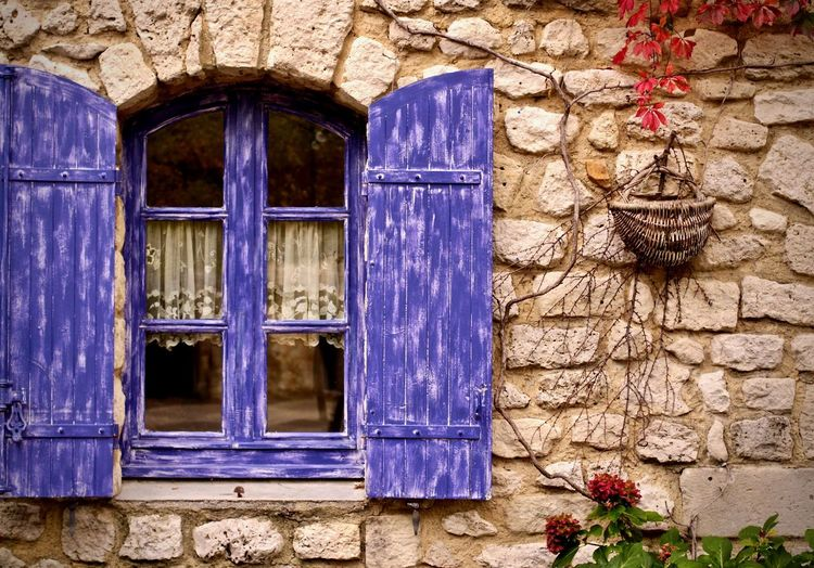 Open purple window of house