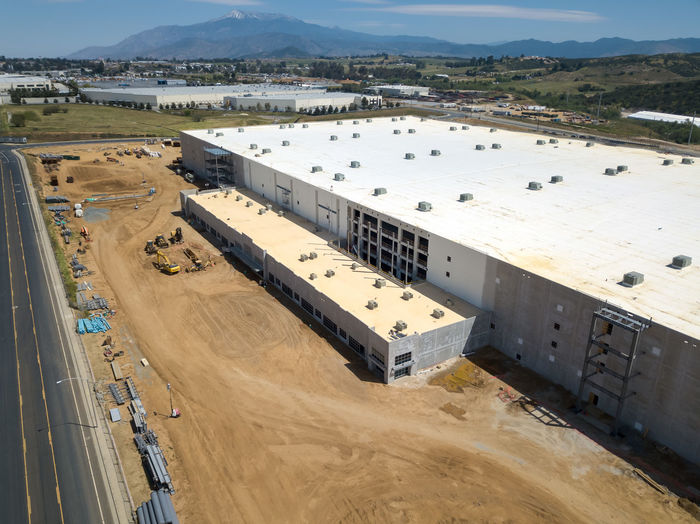 Beaumont, CA / USA - 4/20/2019: Overhead view of a new Amazon Fulfillment Center under construction. High Angle View Day Architecture Built Structure No People Outdoors Construction Construction Site Warehouse Distribution Logistics Equipment New Building  Amazon Overhead View Environment Industry Nature Water Transportation Fuel And Power Generation Sunlight Sky Renewable Energy Business Land Environmental Conservation Mode Of Transportation