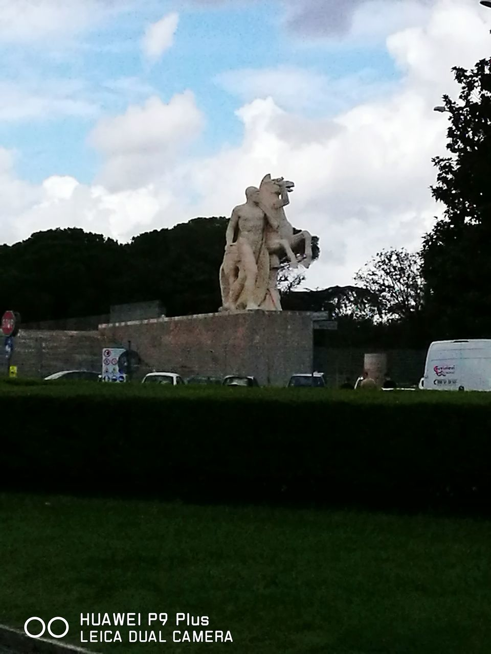 statue, sculpture, art and craft, human representation, sky, park - man made space, tree, cloud - sky, grass, outdoors, day, no people, architecture, nature, mammal