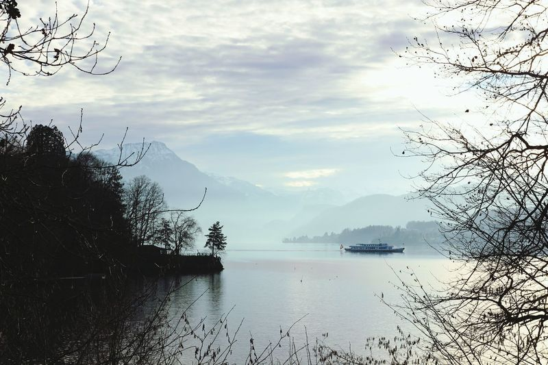 Beauty of lake Luzern Lake Fog Fog Over Water Lake Luzern Switzerland Mountains Winter Boat On Lake Suisse  Nature Outdoor Photography Outdoor