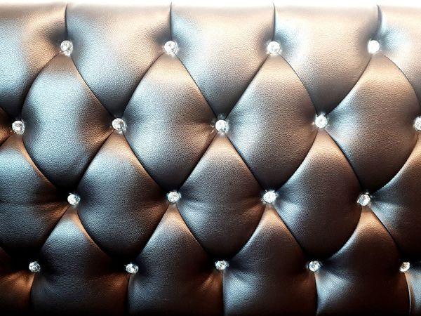 Close up Leather Sofa with crystal decoration, Vintage style Wall Background Lifestyle Business Sofa Vintage Leather Leather Sofa Crystal Design Pattern Designer  Interior Design Cafe Texture Detail Home Retro Old Style Modern Backgrounds Full Frame Close-up Droplet Mosaic Living Room Architectural Detail For Sale Penthouse