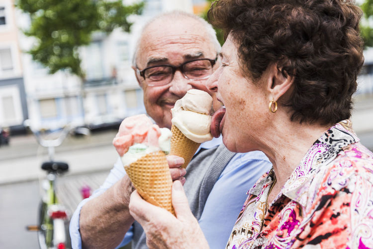 Friends holding ice cream