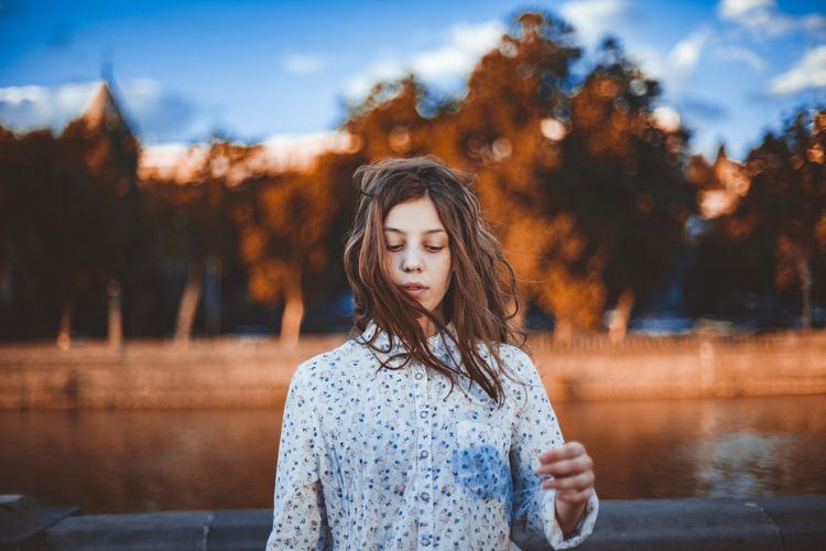 Beautiful Woman Brown Hair Casual Clothing Contemplation Day Focus On Foreground Front View Hair Hairstyle Lake Long Hair Looking Nature One Person Outdoors Portrait Real People Teenager Water Young Adult Young Women Summer Road Tripping The Portraitist - 2018 EyeEm Awards