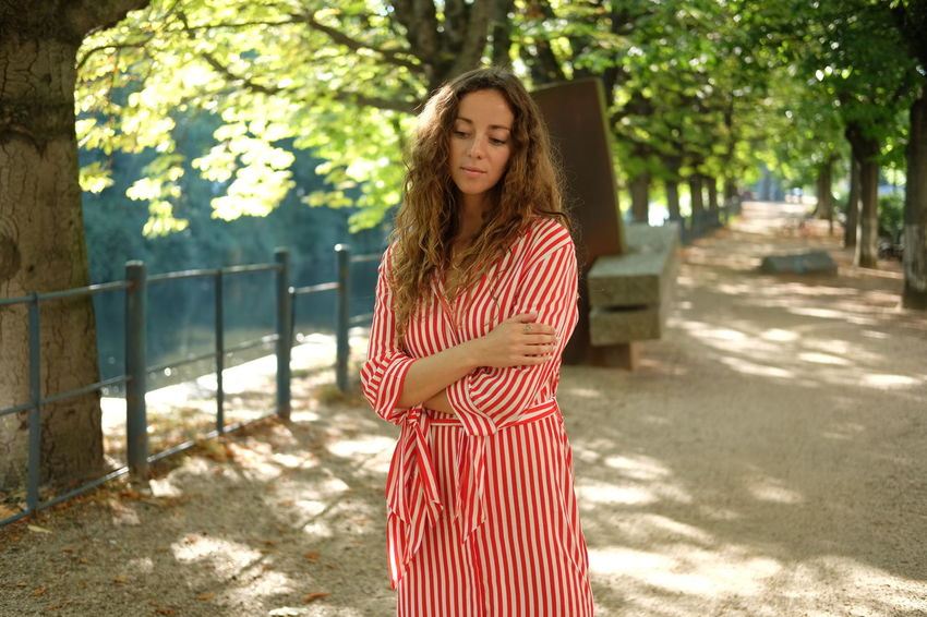 Summer in the park Beautiful Woman Casual Clothing Day Focus On Foreground Front View Hair Hairstyle Leisure Activity Lifestyles Nature One Person Outdoors Plant Real People Standing Striped Sunlight Three Quarter Length Tree Young Adult Young Women