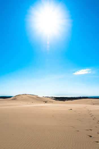 Arid Climate Atmospheric Beach Beauty In Nature Blue Bright Climate Day Desert Environment Land Landscape Nature No People Non-urban Scene Outdoors Sand Sand Dune Scenics - Nature Sky Sun Sunlight Tranquil Scene Tranquility