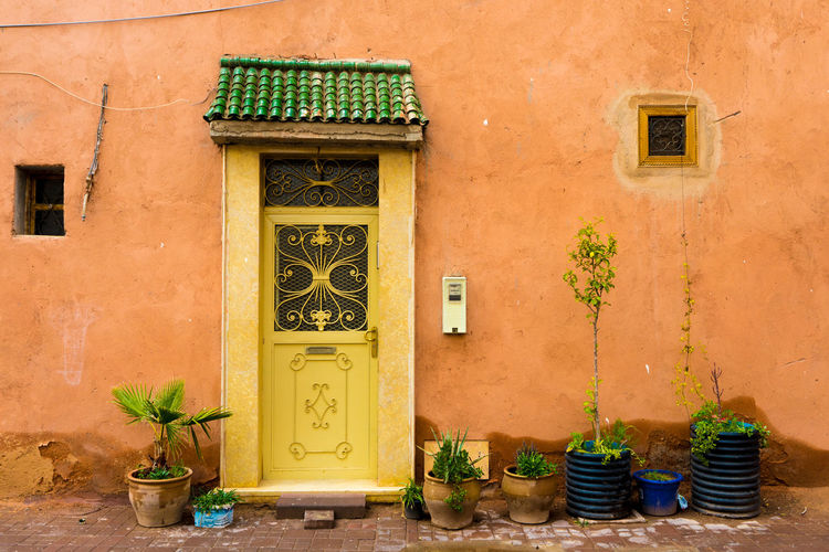 Marrakech medina Entrance Home Medina Arabic Architecture Architecture Building Exterior Built Structure Day Door No People Outdoors Plant Potted Plant Window
