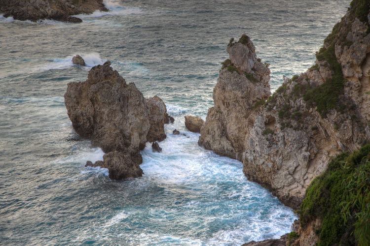 Cliffs with rough waters, Corfu, Greece. Cliffs Rock Rock Formation Beach Beauty In Nature Cliff Cliffside Day Nature No People Outdoors Rock - Object Rock Formation Rocks Scenics Sea Seascape Water Wave