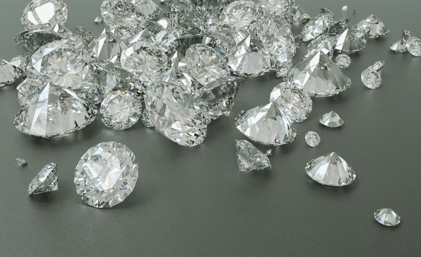 Close-up high angle view of diamonds on gray background