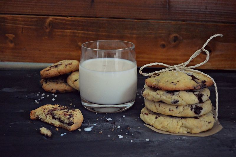 Close-up of milk and cookies on table