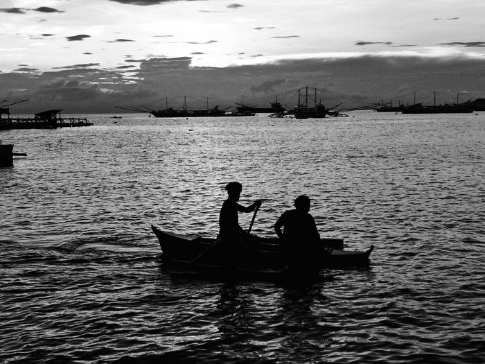 Silhouette Boat Sky Togetherness Fisherman Sea Sitting Outdoors Occupation Waterfront Sailing Day Nature