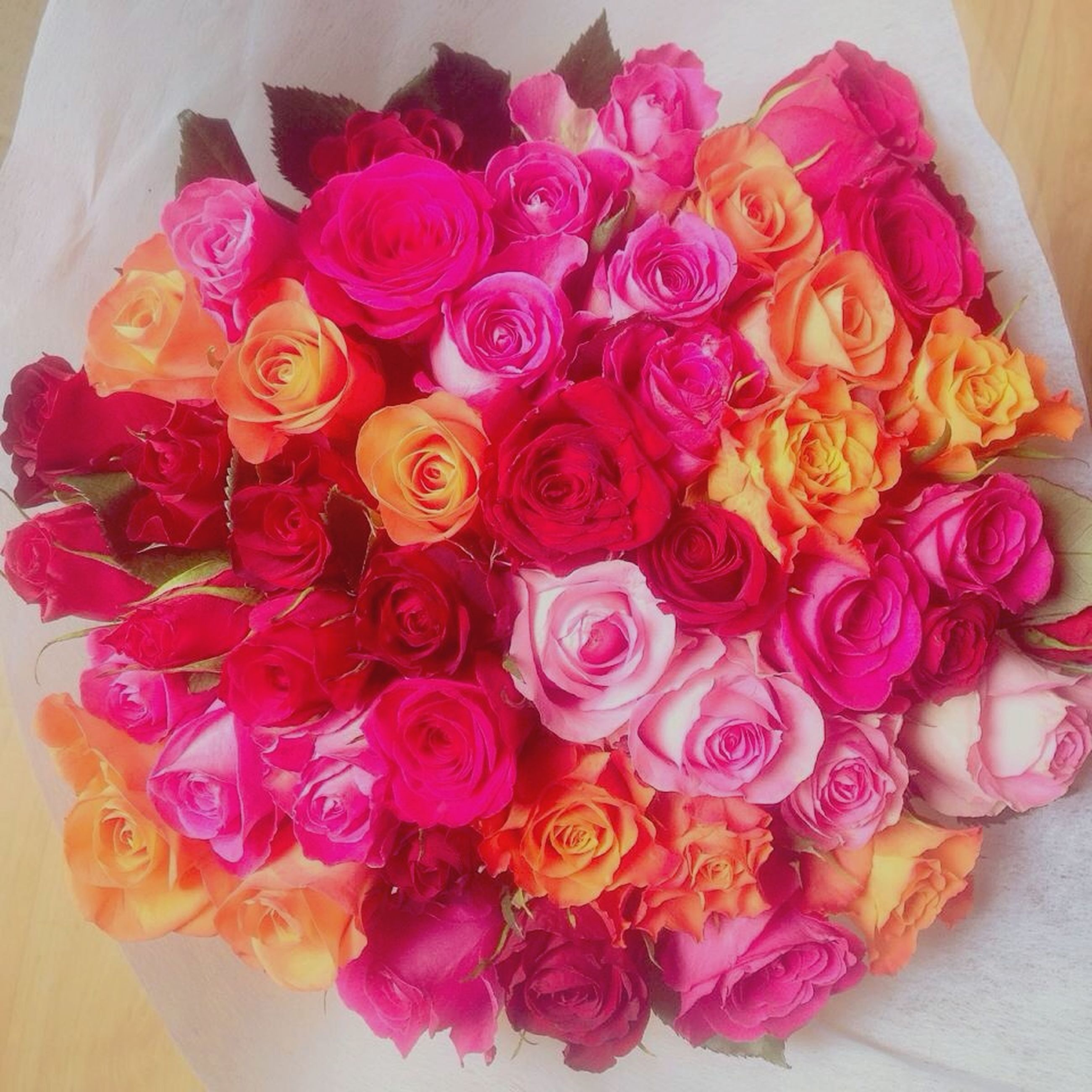 indoors, freshness, flower, still life, high angle view, petal, food, food and drink, multi colored, table, variation, sweet food, close-up, fragility, flower head, bouquet, rose - flower, no people, arrangement, decoration