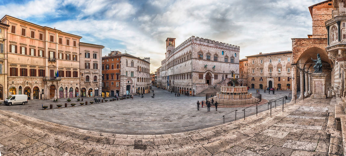 Panoramic view of Piazza IV Novembre, main square and masterpiece of medieval architecture in Perugia, Italy Architecture Building Exterior Built Structure City Cloud - Sky Day History Large Group Of People Outdoors People Sky Tourism Travel Destinations