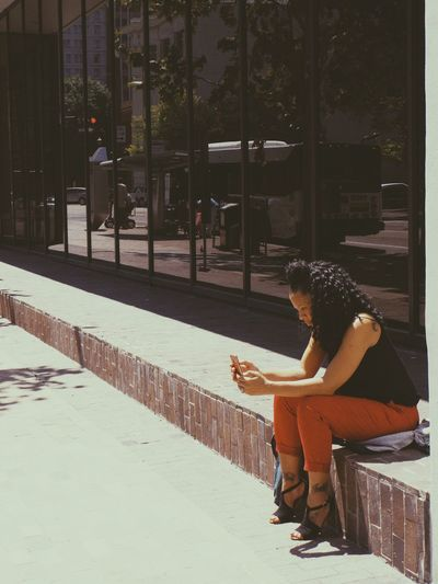 Real People Full Length One Person Sitting Lifestyles Young Adult Women Day Outdoors Young Women Architecture Tree Tensed Adult People Streetphotography Streetphoto
