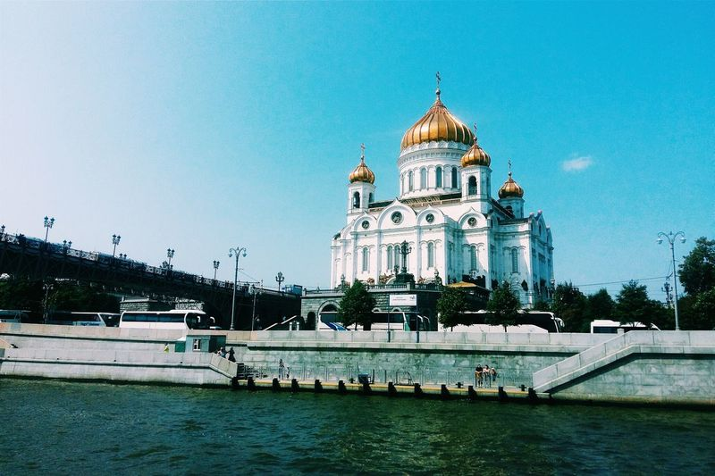 Cathedral of christ the saviour by patriarshy bridge over moskva river against sky
