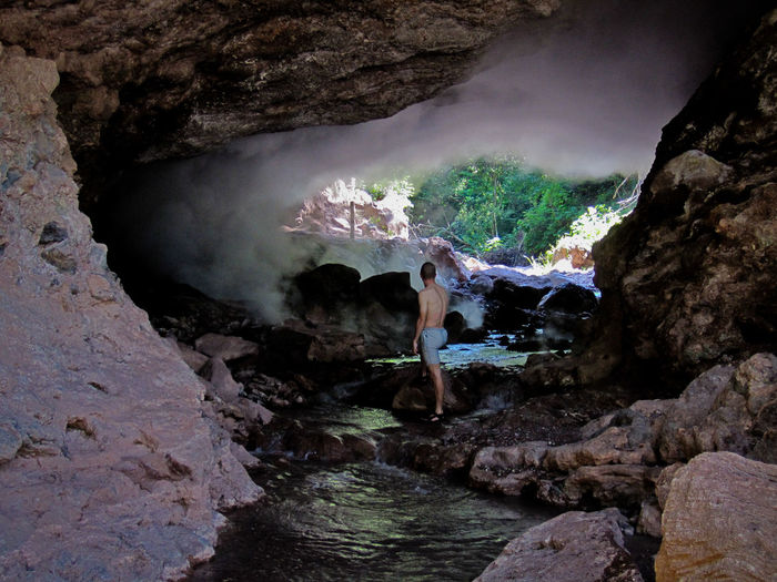 Honduras Aguas Termales De Azacualpa Rock Rock - Object Water Solid Real People Rock Formation Nature Beauty In Nature Physical Geography Motion Cave Mountain Lifestyles Scenics - Nature Leisure Activity Geology Waterfall One Person Outdoors Flowing Flowing Water Power In Nature