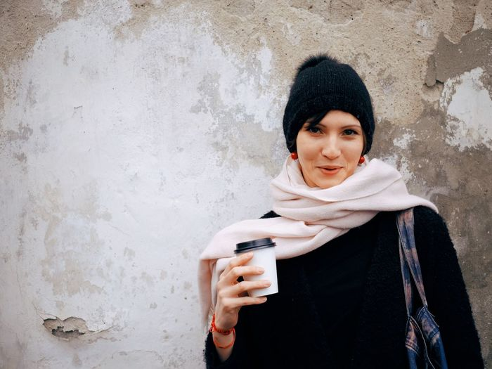 EyeEm Selects One Person Lifestyles Women Wall - Building Feature Young Adult Portrait Warm Clothing Adult Front View Smiling Females Winter Beauty Young Women Looking At Camera Scarf Happiness