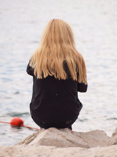 Rear View Water One Person Hair Blond Hair Hairstyle Sea Leisure Activity Women Focus On Foreground Real People Adult Long Hair Nature Day Lifestyles Beach Casual Clothing Outdoors Looking At View