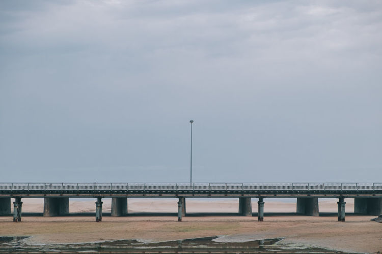 Low tide at the bridge Architectural Column Architecture Bridge Bridge - Man Made Structure Built Structure Connection Day Diminishing Perspective Empty Engineering Lamppost Long Lowtide  Nature No People Order Outdoors Sky Symmetry The Way Forward Tranquility Travel Destinations
