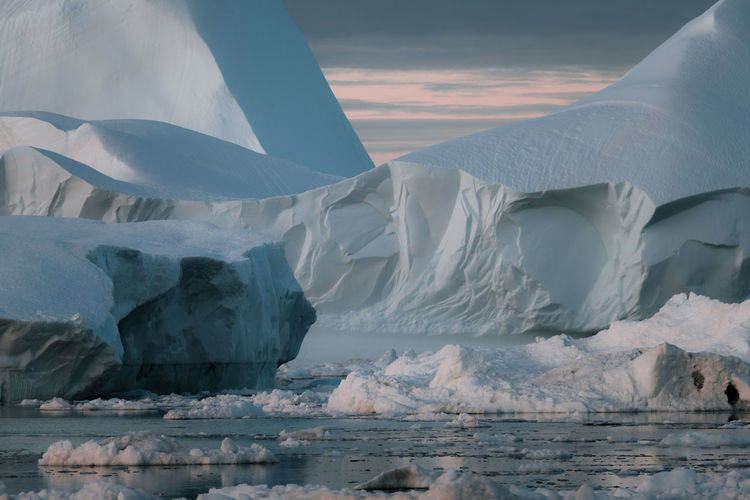 """Icebergs in a sunset depicting the color pantone of the year """"living coral"""" Cold Temperature Ice Snow Winter Glacier Frozen Water Scenics - Nature Environment Iceberg Beauty In Nature Landscape No People Sky Tranquil Scene Tranquility Nature Sunset Outdoors Snowcapped Mountain Melting"""