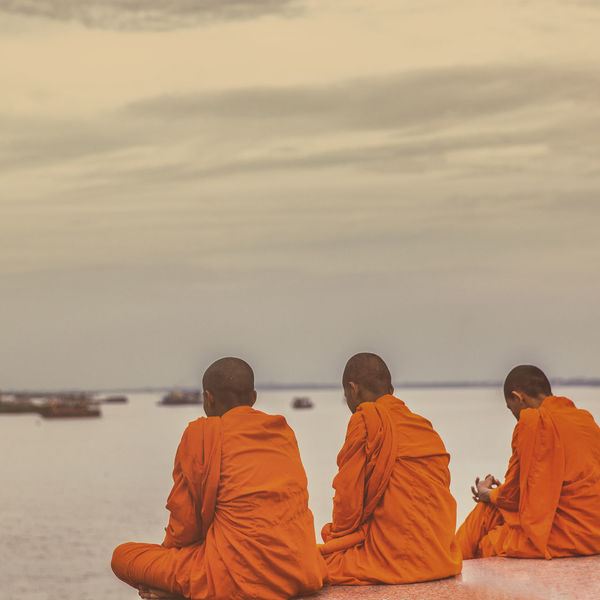 ASIA Cambodia Holiday Men Monks Orange Outdoors People Real People Religion Sitting Spirituality Sunset Travel