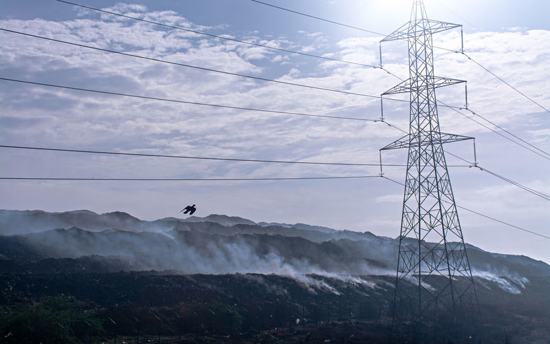 Smocking Hell - DUmping Yard Beauty In Nature Cable Cloud - Sky Connection Day Electricity  Electricity Pylon Fuel And Power Generation Low Angle View Mountain Mountain Range Nature No People Non-urban Scene Outdoors Power Line  Power Supply Scenics - Nature Sky Technology