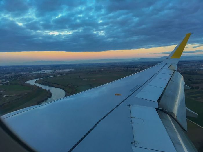 Airplane Transportation Aircraft Wing Sky Cloud - Sky Aerial View Mode Of Transport Flying Nature Travel Air Vehicle Beauty In Nature Journey Scenics Airplane Wing No People Outdoors Sunset Day