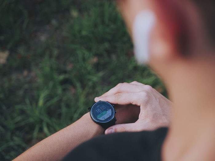 Cropped image of person wearing smart watch