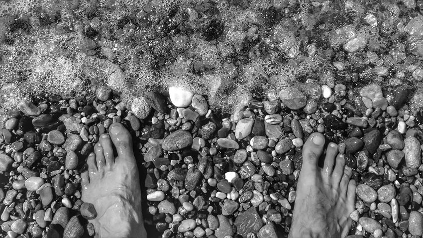 EyeEm Man Black And White Blackandwhite Photography Pebble Beach Low Section Water Beach Women Men Human Leg Pebble Sunlight Shore Sea