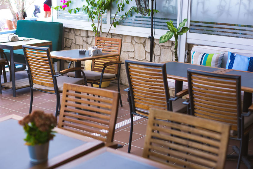 Empty restaurant Economy Food And Drink Service Absence Arrangement Basket Business Cafe Chair Container Day Empty Empty Restaurant Food Furniture Indoors  No People Plant Potted Plant Restaurant Seat Table Wicker Wood - Material