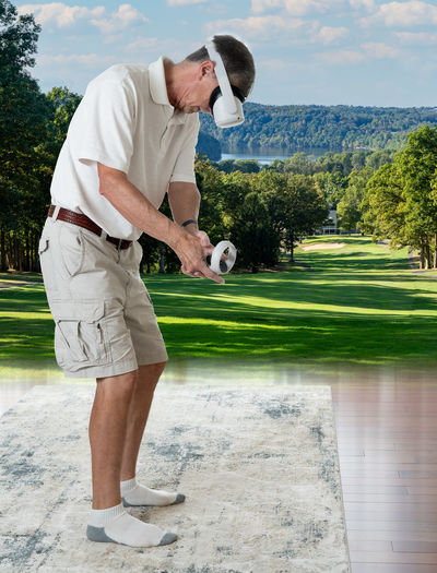 Full length of man standing on golf course