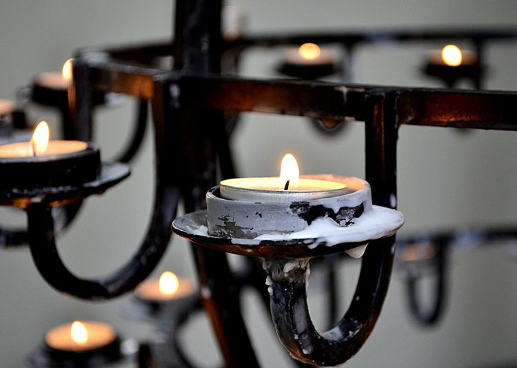 Religious candles in Iceland EyeEm Best Shots Hope Iceland Burning Candle Close-up Fire Flame Glowing Illuminated Indoors  No People Pjpink Place Of Worship Religion Remembrance Tea Light