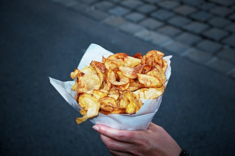 I can't stop eating them ... Chips Close-up Crispy Day Fat Focus On Foreground Food Food And Drink Freshness Holding Leisure Activity Outdoors Potato Potatochips Ready-to-eat Selective Focus Snack Street Street Food Temptation Unhealthy Unhealthy Eating