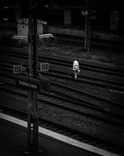 Rear view of man on railroad station platform