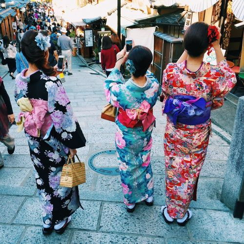 Women in traditional clothing in alley