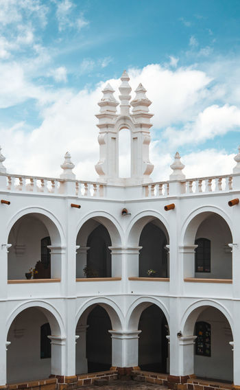 The White City - Sucre - Bolivia's capital. City Cityscape Historical Building Travel Arch Architectural Column Architecture Building Building Exterior Built Structure Cloud - Sky Historic History Minimalism No People No People, Outdoors Simplicity Sky Symmetry The Past Travel Destinations Urban White White Color The Architect - 2018 EyeEm Awards Springtime Decadence
