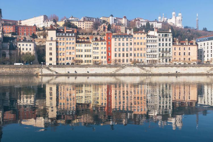 Reflection of old buildings in river