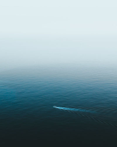 Lone boat in the middle of the ocean. Mallorca, Spain. Landscape_Collection Mallorca SPAIN Beauty In Nature Blue Boat Deep Explore Idyllic Landscape Marine Nature No People Ocean Outdoors Roam Scenics - Nature Sea Ship Simple Simplicity Sky Tranquil Scene Tranquility Water