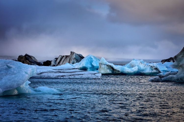 Iceland - icebergs Cold Temperature Winter Ice Sea Weather Frozen Tranquility Beauty In Nature Tranquil Scene Iceberg Sky Nature Water Waterfront Scenics Glacier Cloud - Sky Outdoors No People Snow