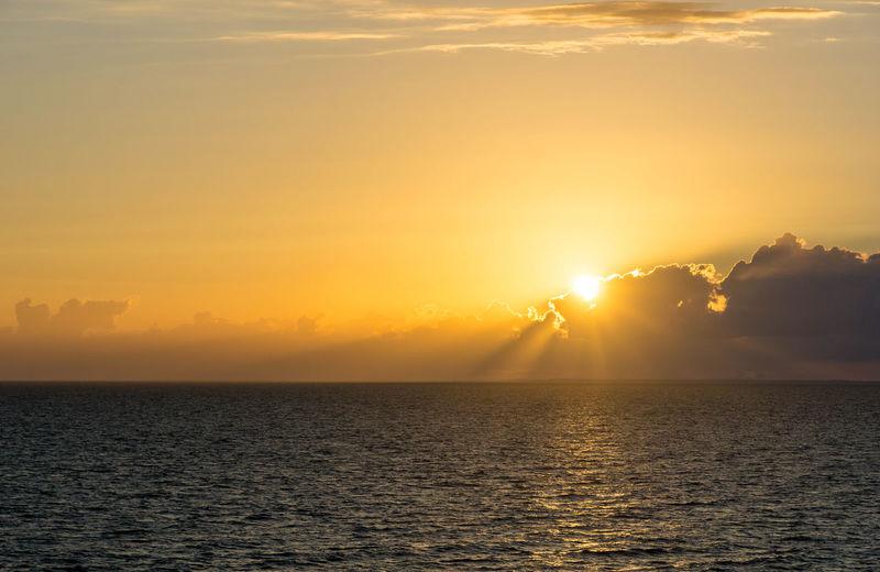 sunset over the baltic sea near rostock Beauty In Nature Bright Cloud - Sky Horizon Over Water Idyllic Nature No People Orange Color Scenics - Nature Sea Silhouette Sky Sun Sunbeam Sunlight Sunset Water Waterfront