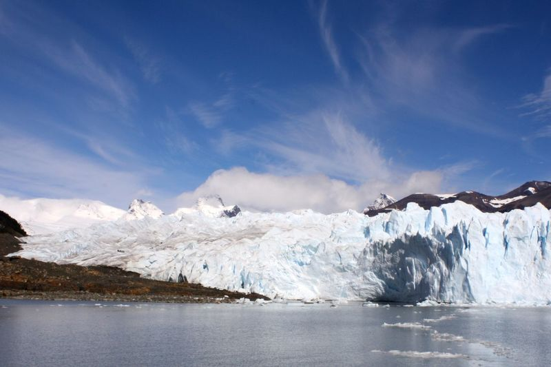 Glacial scenery with ice fall and remote mountain range