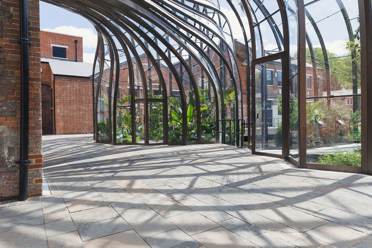 A detailed photograph of the aluminium and glass structure of the Bombay Sapphire Distillery, the re-development of the 300 year old paper Mill Shape Architecture Brick Building Building Exterior Built Structure Day Design Distillery Door England Entrance Gate Glass No People Outdoors Shadow Sunlight