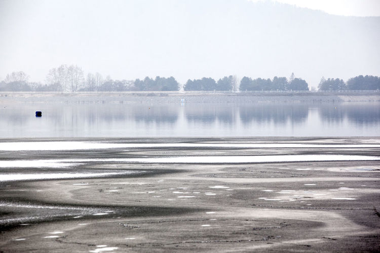 Calm Coastline Distant Foggy Frozen It's Cold Outside Lake Lake View Lakeshore Lakeside Outdoors Power In Nature Reflection Rippled River Riverbank Scenics Standing Water Tranquil Scene Tranquility Water Waterfront Weather Winter