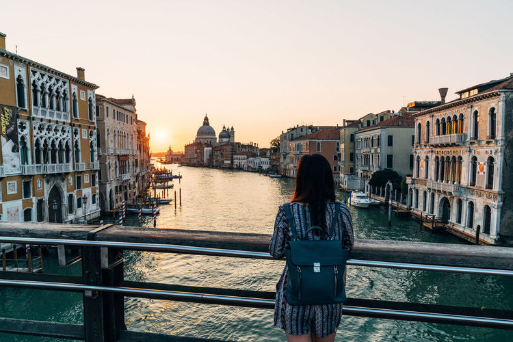 Adult Adults Only Architecture Bridge - Man Made Structure Building Exterior Built Structure City City Break Cityscape Cultures Nautical Vessel One Person One Woman Only Only Women People Real People Rear View Sunset Tourism Tourist Travel Destinations Venice, Italy Women Young Adult Young Women The Great Outdoors - 2018 EyeEm Awards