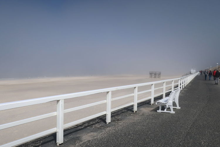 Promenade Sylt Germany Sylt Strand Sylt Collection Barrier Boundary Bridge Built Structure Clear Sky Day Footpath Land Nature No People Outdoors Railing Road Sky Sylt_collection Westerland White Bench