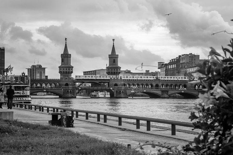 Train On Oberbaum Bridge Over River Against Sky