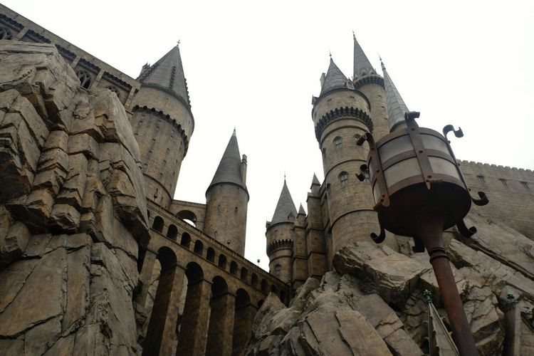 Hogwarts castle at Harry potter universal studio,Osaka japan Building Exterior Outdoor Witch Amusement Park Vacation Japan OSAKA Travel Building Hogwarts Universal Studios  Harrypotter Magic Brick Castle Low Angle View Architecture History Building Exterior Built Structure No People Outdoors