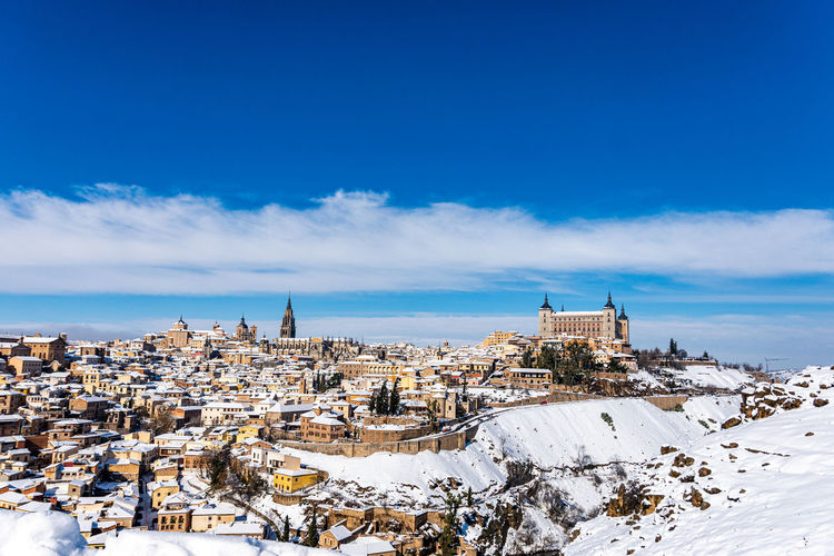 Panoramic view of the city of toledo after the filomena snow storm. urban snowy landscape