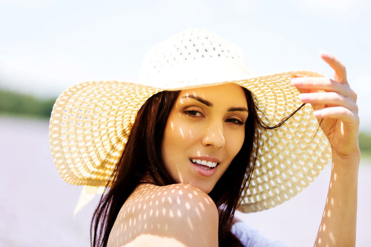 Close-Up Portrait Of Beautiful Woman Wearing Hat