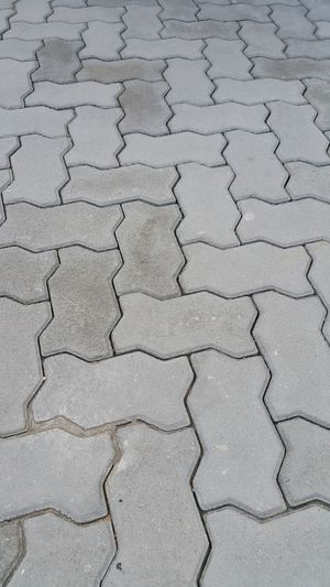 The concrete blocks foot path. Architectural Detail Background Cement Close-up Concrete Block Construction Cracked Day Floor Foot Path Full Frame Gray High Angle View Masonry Nature No People Outdoors Pattern Pavement Stone Surface Texture Textured  Tile Walk Path