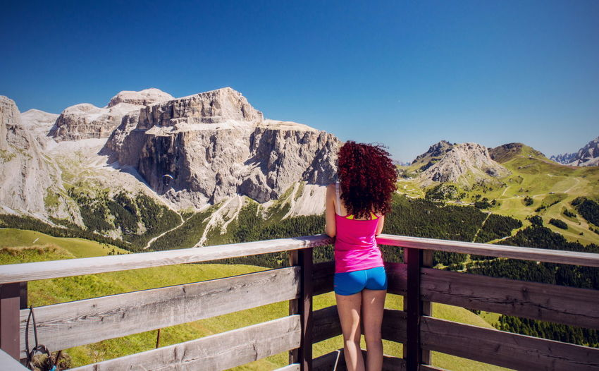 Admiring. Mountain Clear Sky Lifestyles Tranquil Scene Scenics Day Green Color Nature People And Places Trentino  Landscape Trentino Alto Adige Mountain Peak Beauty In Nature Non-urban Scene Passo Rolle Val Di Fassa Dolomiti Italy Girl Curly Hair Blue in Col Rodella